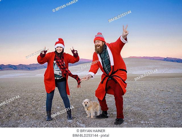 Festive couple celebrating Christmas in the desert