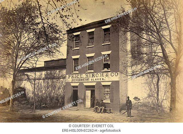 Union army guard and other men in front of a building designated 'Price, Birch & Co., Dealers in Slaves,' in Alexandria, Virginia. Ca. 1863