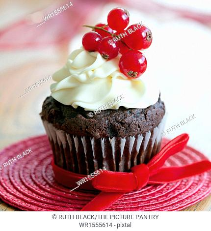Chocolate cupcakes decorated with redcurrants