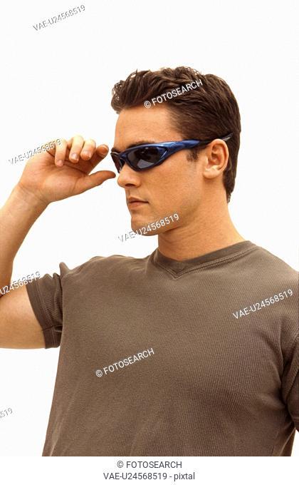 A Caucasian male wearing sun glasses