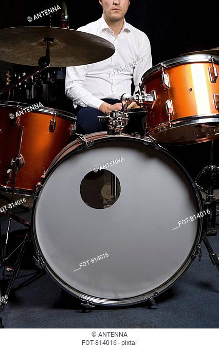 A man sitting at a drum kit