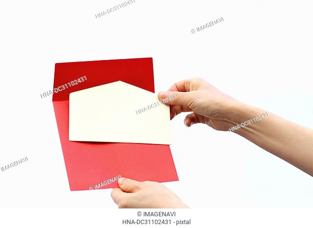 Woman Hand Holding Envelope of Invitation Card
