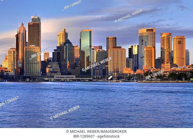 View of Sydney Cove at sunrise, Circular Quay, port, Sydney skyline, Central Business District, Sydney, New South Wales, Australia