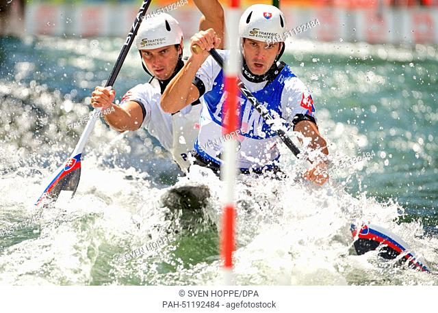 Ladislav Skantar and Peter Skantar of Slowakia paddle down the ice canal during the canoe double (C2) at the men's Canoe slalom World Cup final in Augsburg