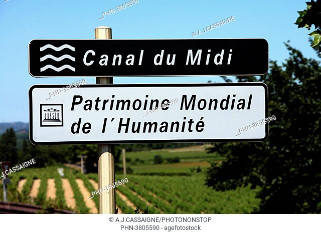 France, Canal du Midi, the canal sign with a blue sky and blurred landscape in the background