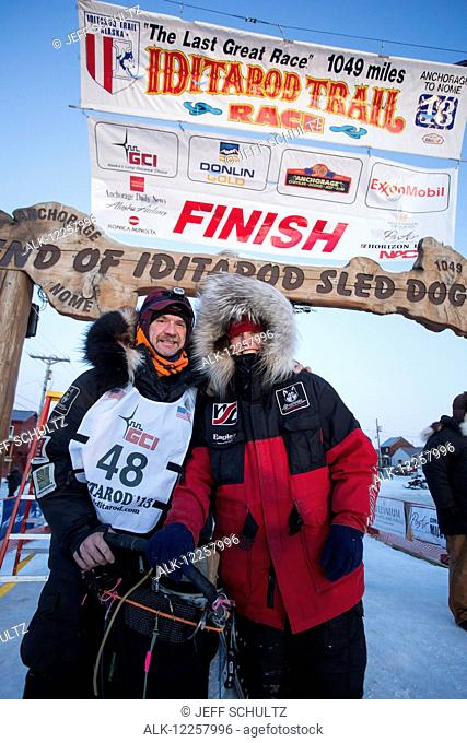Second place finisher Aliy Zirkle poses with her husband Allen Moore at the finish line shorlty after Allen finished in 33rd place, 2013 Iditarod, Arctic Alaska