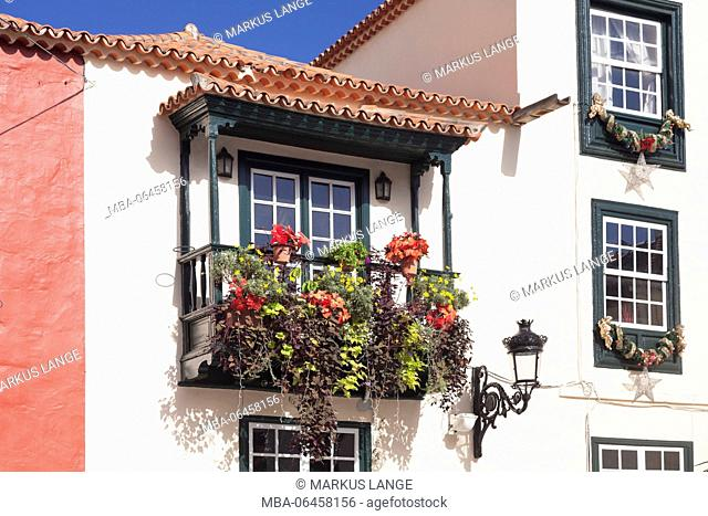 Flower-decorated wooden balcony, Placeta de Borrero, Santa Cruz de la Palma, La Palma, Canary islands, Spain