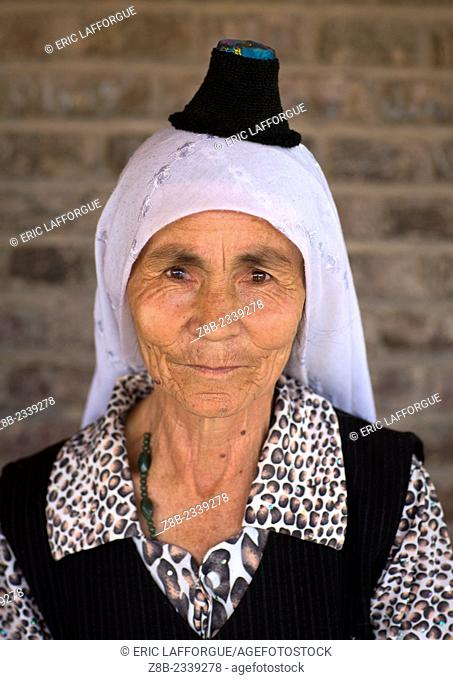 Uyghur Woman Wearing The Smallest Hat In The World, Keriya, Xinjiang Uyghur Autonomous Region, China