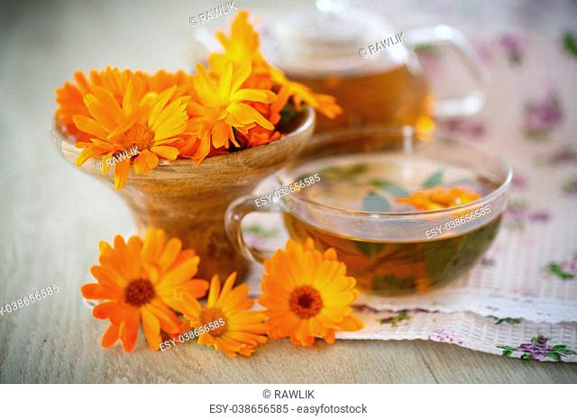 Herbal tea with marigold flowers on the table