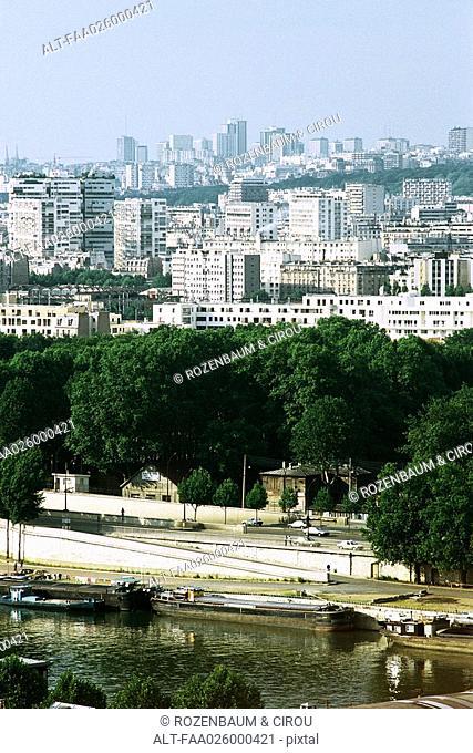 Cityscape and barges, River Seine, Paris, France