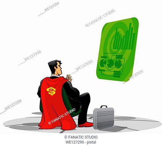 Super hero examining a virtual screen