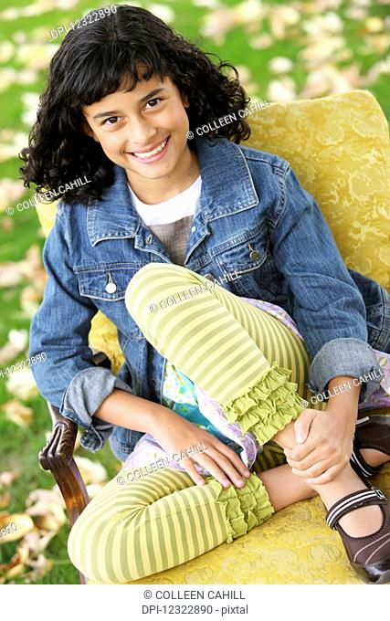 Portrait of a girl sitting on a chair; Oregon, United States of America