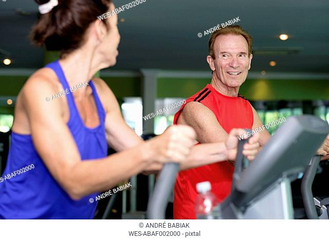 Senior couple working out at gym