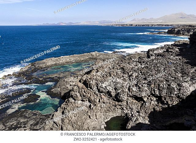 Formation of natural pools along the coast. Lanzarote. Spain