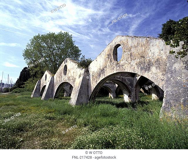 Old weathered archways in field