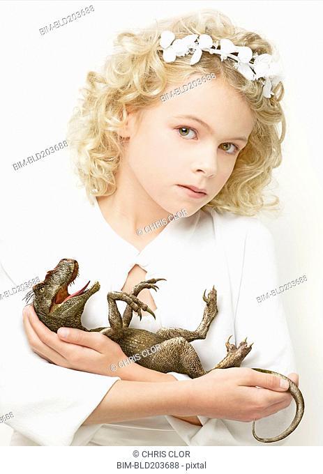 Girl cradling baby dinosaur