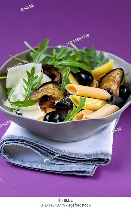 Pasta salad with aubergines, olives, rocket and parmeasn