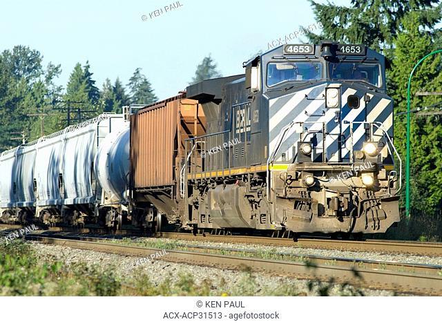A BC Rail locomotive leads a mixed freight train through Burnaby, British Columbia, Canada