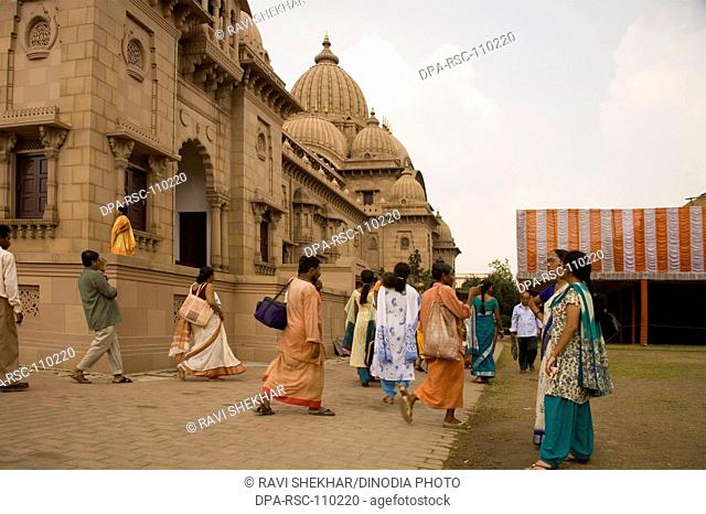 Devotees visited in Belur math headquarter of Ramakrishna mission founded by philosopher Vivekananda on the bank of river hooghly ; Calcutta now Kolkata ; West...