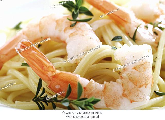 Spaghetti with prawns on plate