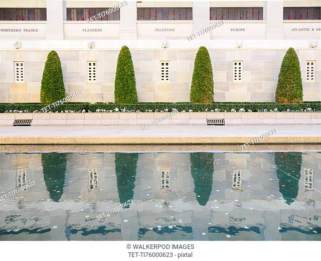 Topiary by reflecting pool at Australian War Memorial in Canberra, Australia