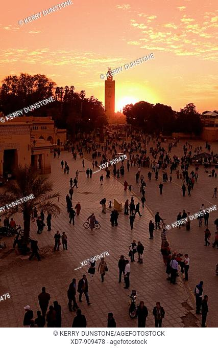Morocco Marrakesh Place Djemâa el-Fna at dusk and Koutoubia Mosque