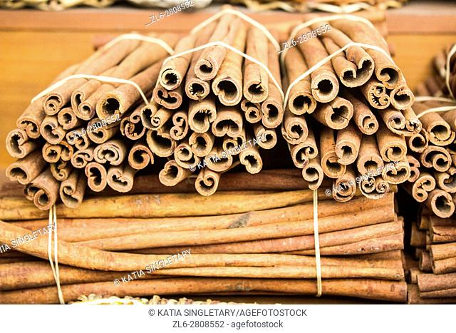 Cinnamon sticks bundle together on displays and for sale in an outdoor market in Athens, Greece, Europe