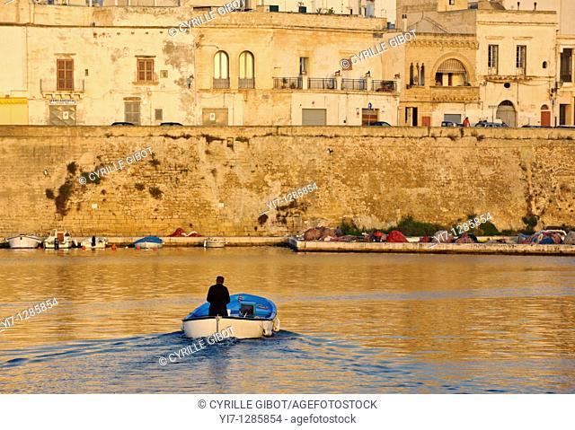 Fishing boat in the port of Gallipoli at sunrise, Puglia, Italy