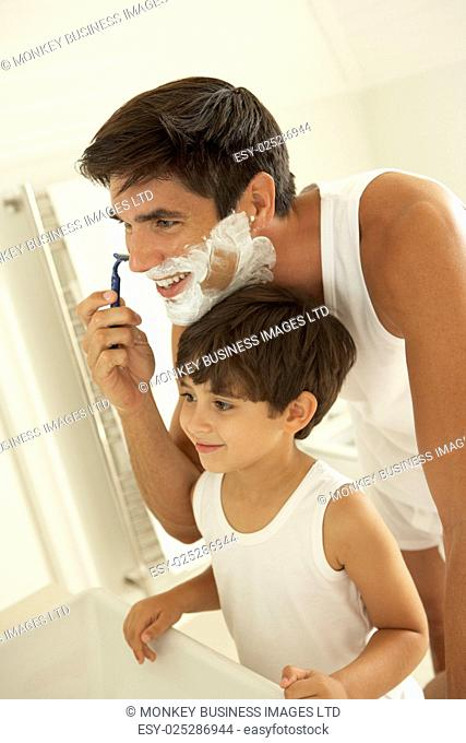 Son Watching Father Wet Shaving With Razor