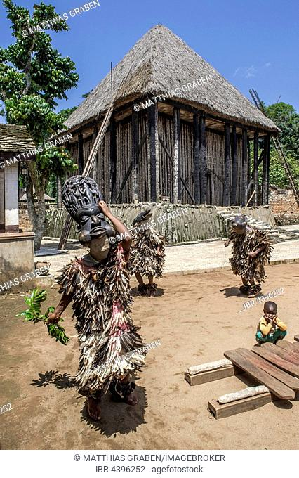 Dancers in traditional clothing wearing carved masks, Atchum, Fon's Palace, Bafut, Bamenda, North-West Region, Cameroon