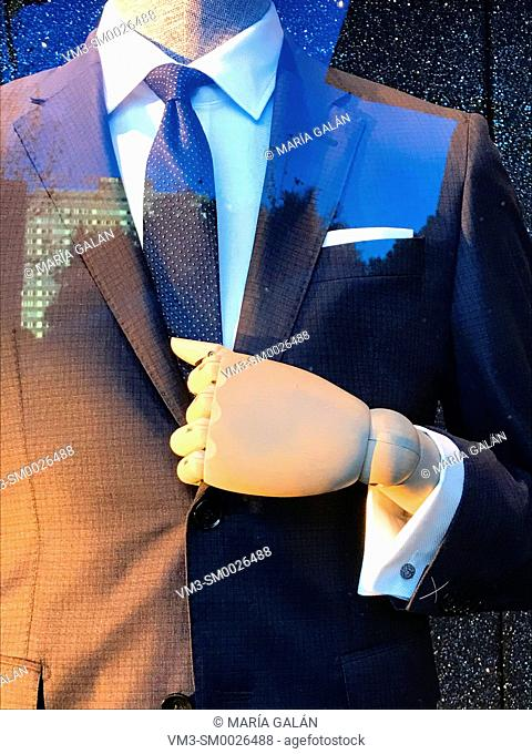 Mannequin in a shop window wearing suit
