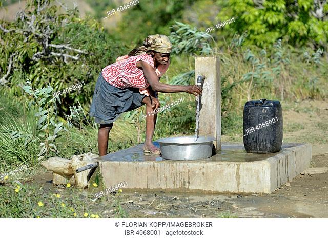 Elderly woman at a water supply well, Ridore, La Vallee, Sud-Est Department, Haiti