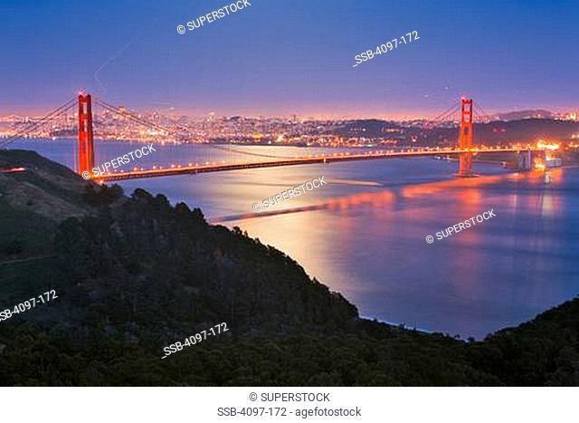 Suspension bridge lit up at dusk, Golden Gate Bridge, San Francisco Bay, San Francisco, California, USA
