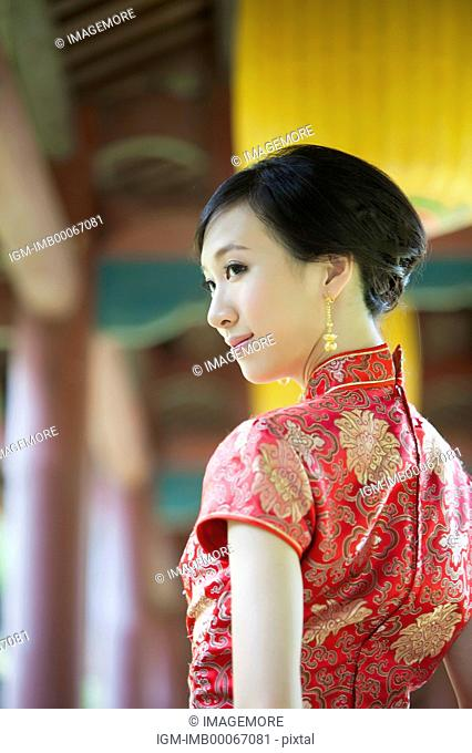Young woman with cheongsam looking away