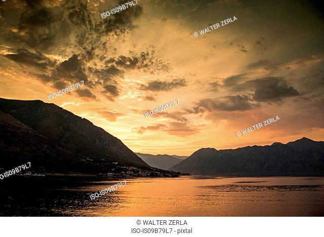 Silhouette of mountains by water at sunset, Kotor, Montenegro, Europe