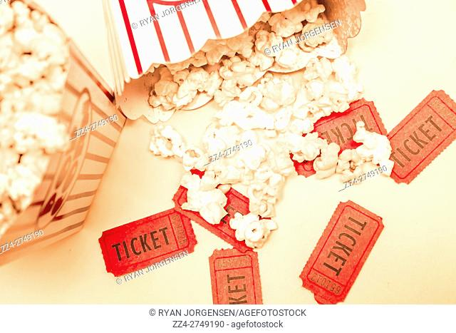 Classic movies conceptual with a top view of scattered popcorn on cinema tickets