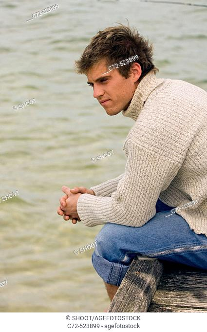 Man sitting on pier