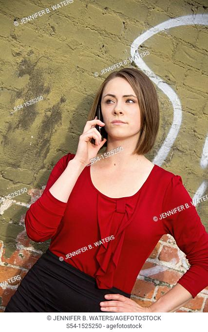 Young businesswoman of Russian descent talking on a cellular phone