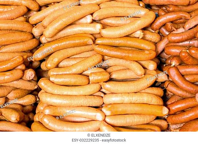 Different kinds of sausages on a market