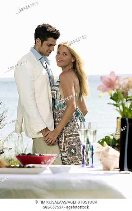Young couple dining at the beach