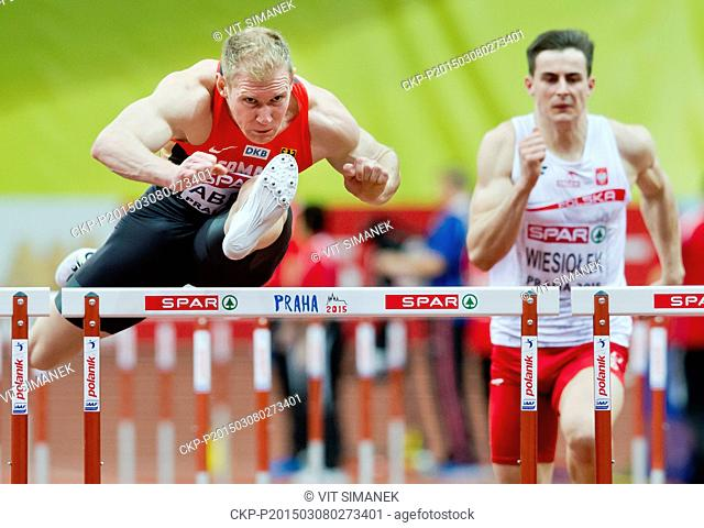 Germany's Arthur Abele, left and Poland's Pawel Wiesiolek, clear a hurdle in the 60m hurdles of the men's heptathlon during the European Athletics Indoors...