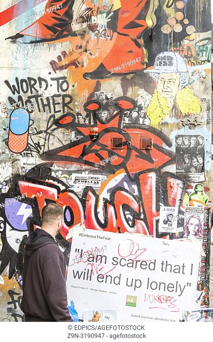 "street art collage, man looking at the sentence """"I'm scared that I will end up lonely"""", london, england"