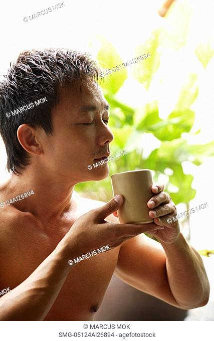profile of man smelling tea