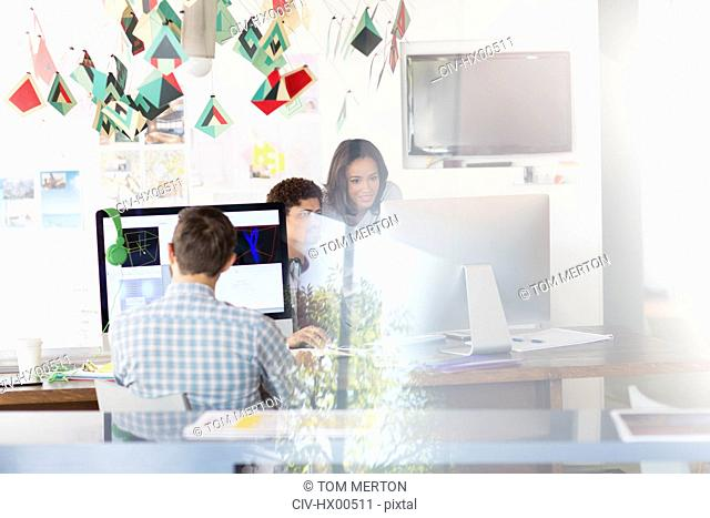 Creative business people working at computers in office