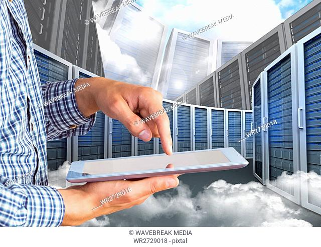 Digital composite image of businessman using digital tablet against server tower