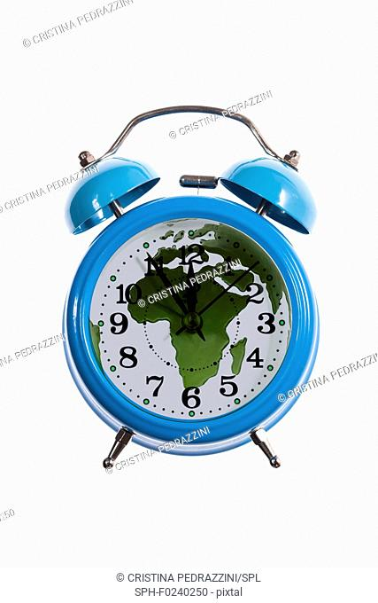 Alarm clock and world map with africa. Composite image depicting doomsday clock