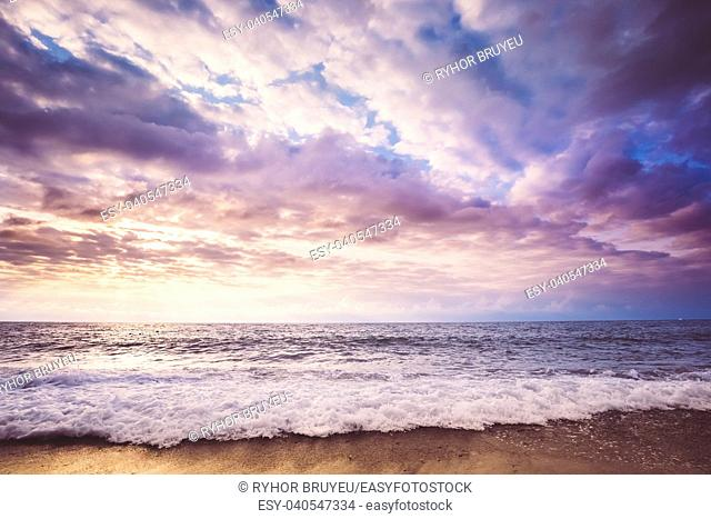 Sea Or Ocean Waves And Colorful Sunset Or Sunrise Sky Background. Waves Washing Sand Beach