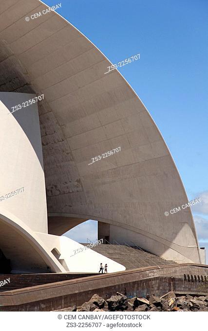 People walking near the Auditorium de Tenerife, concert hall created in an avant-garde style, designed by star architect Santiago Calatrava, Santa Cruz