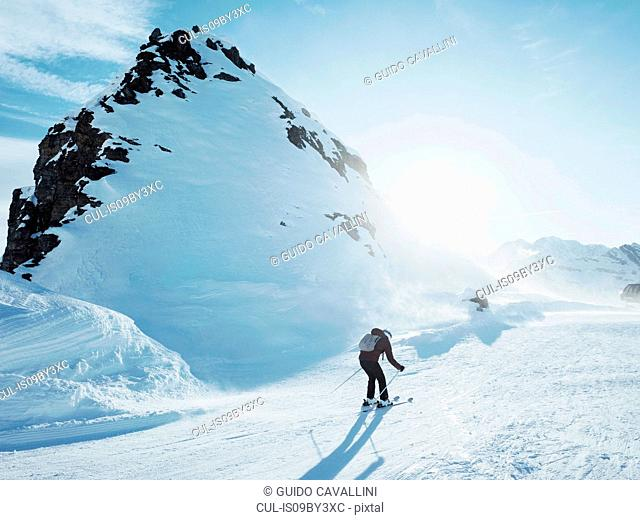 Young female skier skiing in snow covered landscape, Alpe Ciamporino, Piemonte, Italy