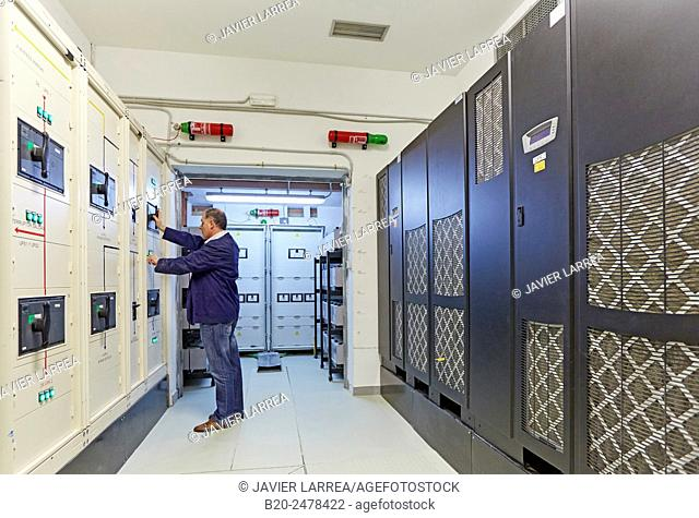 Technician by electrical panels at maintenance area, batteries for uninterrupted electricity, Hospital Donostia, San Sebastian, Basque Country, Spain